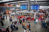 People wait in line at the information desk in Hauptbahnhof train station in Munich Germany on Saturday July 23 2016 German Chancellor Angela Merkel...