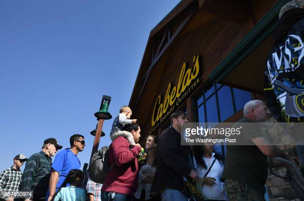 People wait in line during the opening of a new Cabela's store on Thursday March 09 2017 in Gainesville VA