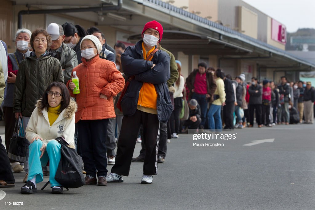 People wait in line for a supermarket to open as limited food continues to cause problems for people in the earthquake effected areas on March 20, 2011 in Ichinoseki, Iwate, Japan. More than a week after the magnitude 9 earthquake and tsunami struck Japan the death toll has risen to 8,200 dead with still thousands missing. Presently the country is struggling to contain a potential nuclear meltdown after the nuclear plant was seriously damaged from the quake.