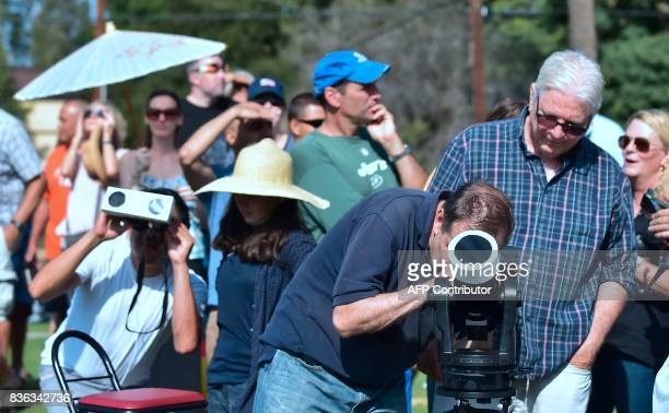 People wait in line for a telescope view of the partial eclipse from Beckman Lawn at Caltech in Pasadena California on August 21 2017 Emotional...