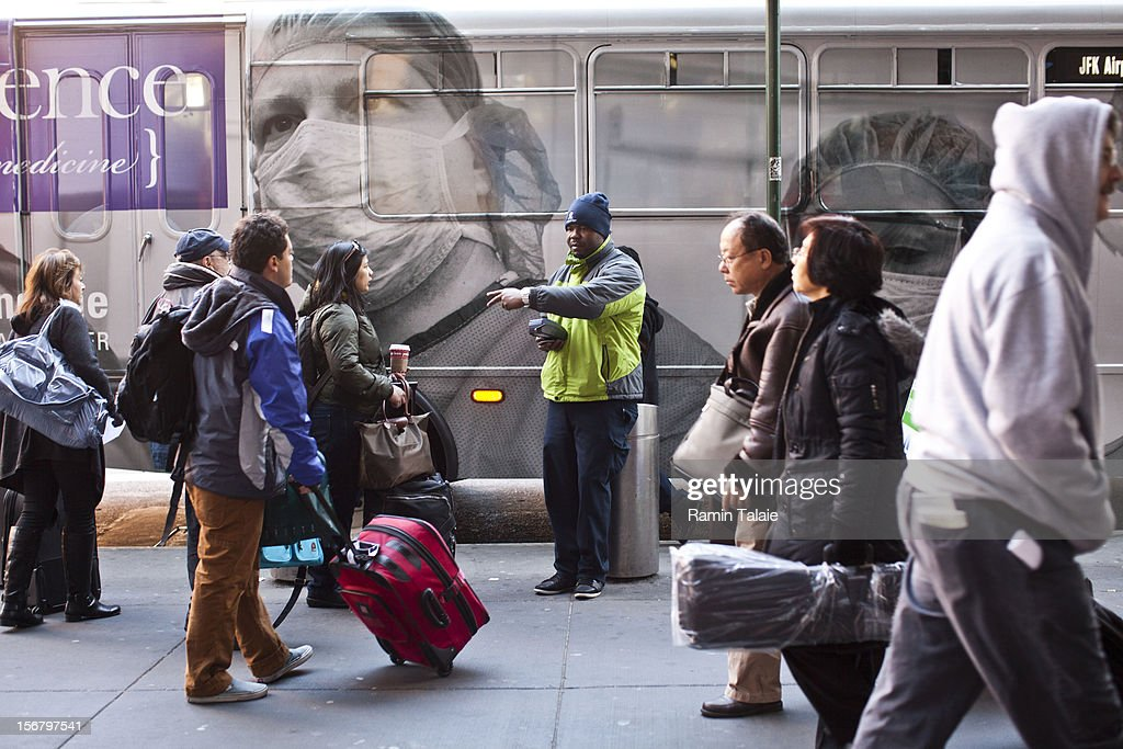 People wait in line for airport buses outside of the New York Port Authority bus terminal in Manhattan on November 21, 2012 in New York City. The Port Authority of New York and New Jersey is expecting to handle a high number of travelers at its hubs, bridges, and tunnels ahead of the Thanksgiving holiday.