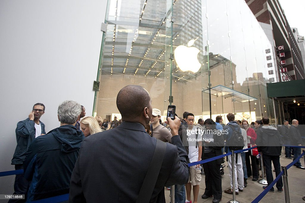 People wait in line for Apple's new iPhone 4s at the Apple Store on Broadway and 67th Street on October 14, 2011 in New York City. The new phone, which went on sale at 8 am local time in the U.S., Canada, U.K., Japan, Australia, France and Germany, features a faster dual-core A5 chip, an 8MP camera that shoots 1080p HD video, and a voice assistant program.