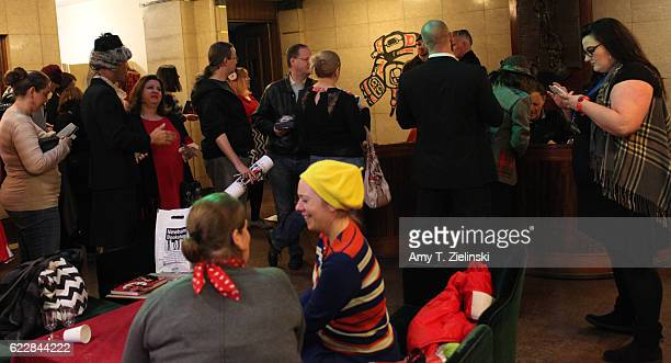 People wait in line for signed autographs with actor Ian Buchanan who portrayed Dick Tremayne and actor Chris Mulkey who portrayed Hank Jennings on...