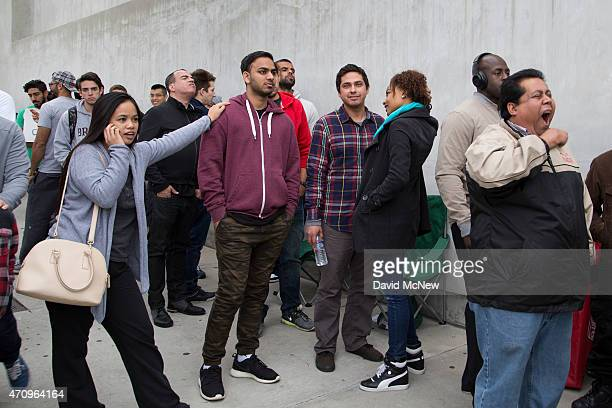 People wait in line for the release of the Apple Watch to customers at the Maxfield in LA store on April 24 2015 in Los Angeles California The...