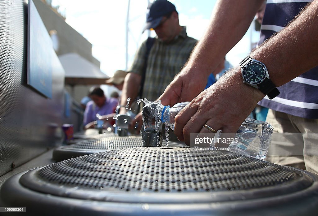 People wait in line for the water fountain on day four of the 2013 Australian Open at Melbourne Park on January 17, 2013 in Melbourne, Australia.