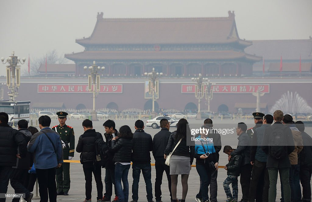 People wait in line for Tiananmen Square to be opened in Beijing, China, on Wednesday, March 6, 2013. China maintained its economic-growth target at 7.5 percent for 2013 while setting a lower inflation goal of 3.5 percent, setting up a challenge for new leaders to keep prices in check without harming expansion. Photographer: Tomohiro Ohsumi/Bloomberg via Getty Images