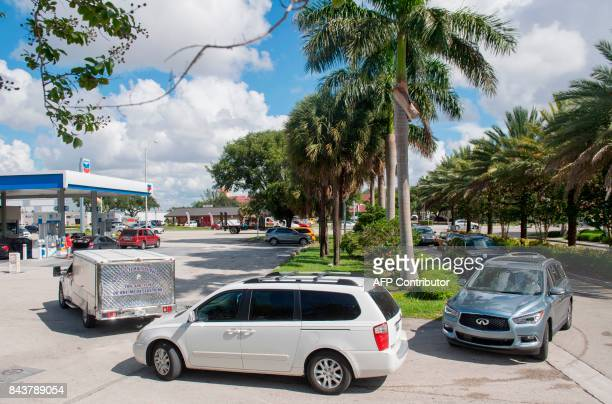 People wait in line in for gas for their cars at a Chevron Gas Station as they prepare for Hurricane Irma in Miami Florida September 7 2017 Miami...