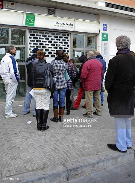 People wait in line in front of a government employment office in the Cruz Roja suburb of Sevilla on January 27 2012 Spain's unemployment rate shot...