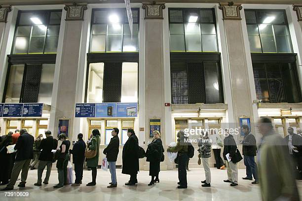 People wait in line inside the James A Farley post office building in the early evening April 17 2007 in New York City With the tax deadline of...