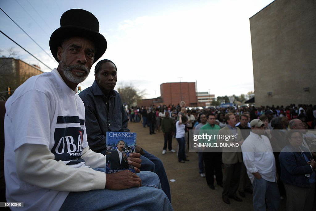 People wait in line making their way to the entrance to watch US Democratic presidential candidate Illinois Senator Barack Obama outside a rally at...