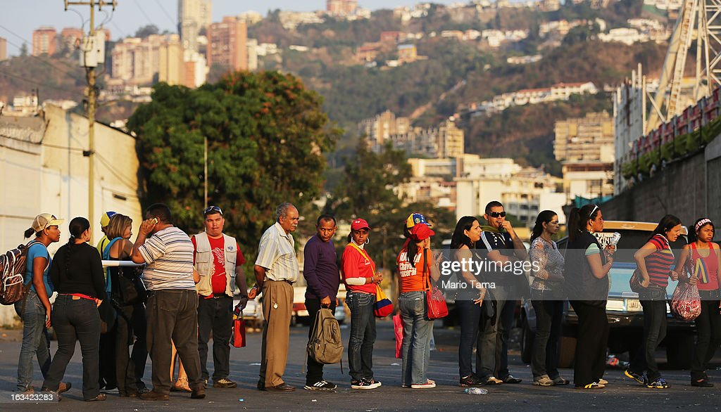 People wait in line more than a kilometer away to view the body of deceased Venezuelan President Hugo Chavez on March 9, 2013 in Caracas, Venezuela. Venezuelans continue to wait in line for hours to pay their last respects to Chavez on the day after his funeral. Venezuela's elections commission has set April 14 as the date for voting to replace the late Chavez.