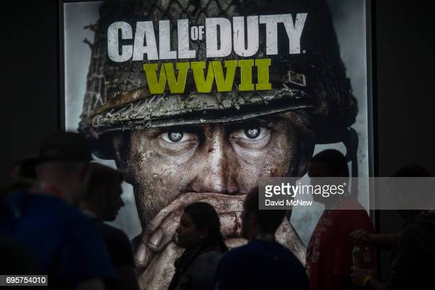 People wait in line of to see a demonstration Call of Duty WWII at the Activision exhibit on opening day of the Electronic Entertainment Expo at the...