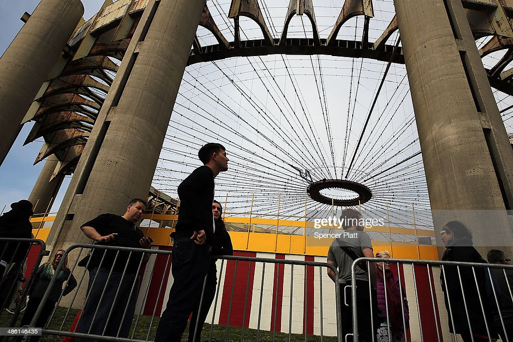 People wait in line outside of the dilapidated New York State Pavilion during festivities marking the anniversary of the 1964 World's Fair which...