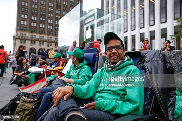 People wait in line outside the Apple Store on 5th Avenue to buy new 'iPhone 6' in New York United States on September 9 2014