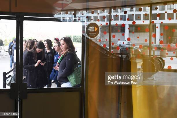People wait in line outside the Hirshhorn Museum and Sculpture Garden to see the Yayoi Kusama Infinity Mirrors exhibit on Monday February 27 2017 in...