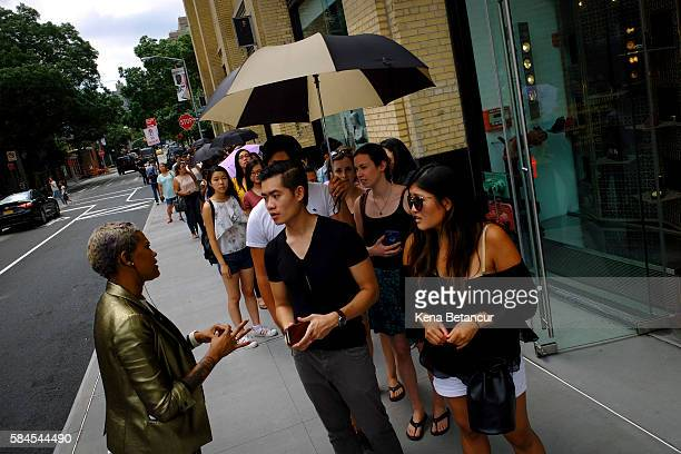 People wait in line outside the new Museum of Ice Cream across from the Whitney Museum on July 29 2016 in New York City The temporary museum...