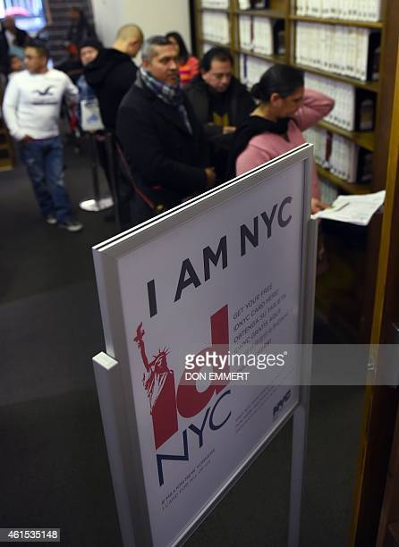 People wait in line to be processed for their New York City municipal ID cards January 14 2015 at a midtown library in New York One piece of plastic...