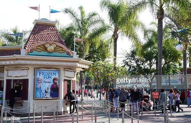 People wait in line to buy tickets for entry to Disneyland on January 22 2015 in Anaheim California The theme park known as 'The Happiest Place on...