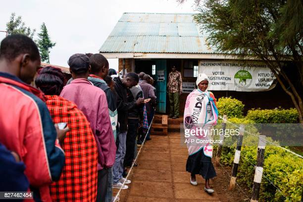 TOPSHOT People wait in line to cast their ballot in the general elections at a polling station at Langas Primary School in the Rift Valley town of...