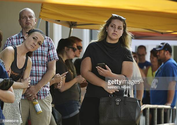 People wait in line to donate blood at the Oneblood center on June 13 2016 in Orlando Florida The call went out for blood donors in the aftermath of...