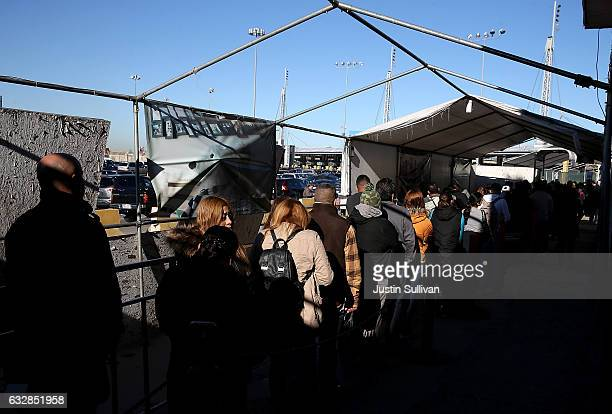 People wait in line to enter the United States at the San Ysidro Port of Entry on January 27 2017 in Tijuana Mexico US President Donald Trump...