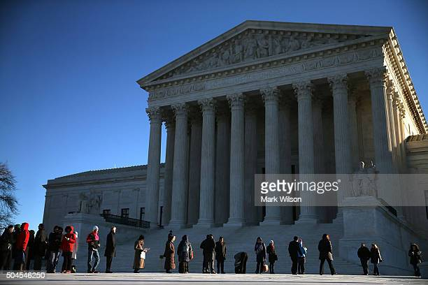 People wait in line to enter the US Supreme Court building January 11 2016 in Washington DC The high court is hearing arguments in the Friedrichs v...
