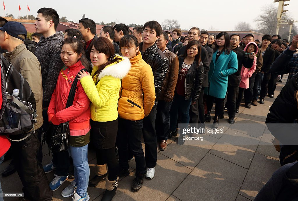 People wait in line to enter Tiananmen Gate in Beijing, China, on Thursday, March 14, 2013. Xi Jinping was named China's president by the national legislature, replacing Hu Jintao in the country's most rapid formal transfer of power in more than a generation. Photographer: Tomohiro Ohsumi/Bloomberg via Getty Images