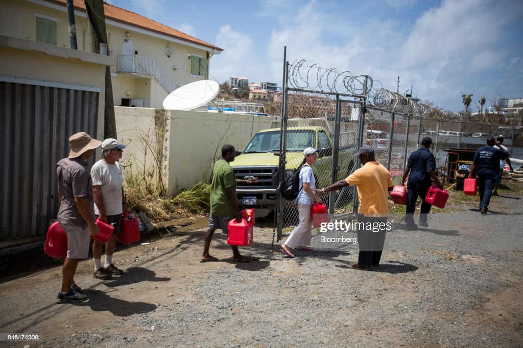 People wait in line to fill containers with gas after Hurricane Irma in St John, U.S. Virgin Islands, on Tuesday, Sept. 12, 2017. After being struck by Irma last week, the U.S. Virgin Islands couldnt look less like a tourist destination. Many local residents are giving up and getting out after losing everything to the category 5 storm,even as the local authorities in the U.S. territory say they are determined to rebuild the islands. Photographer: Michael Nagle/Bloomberg via Getty Images