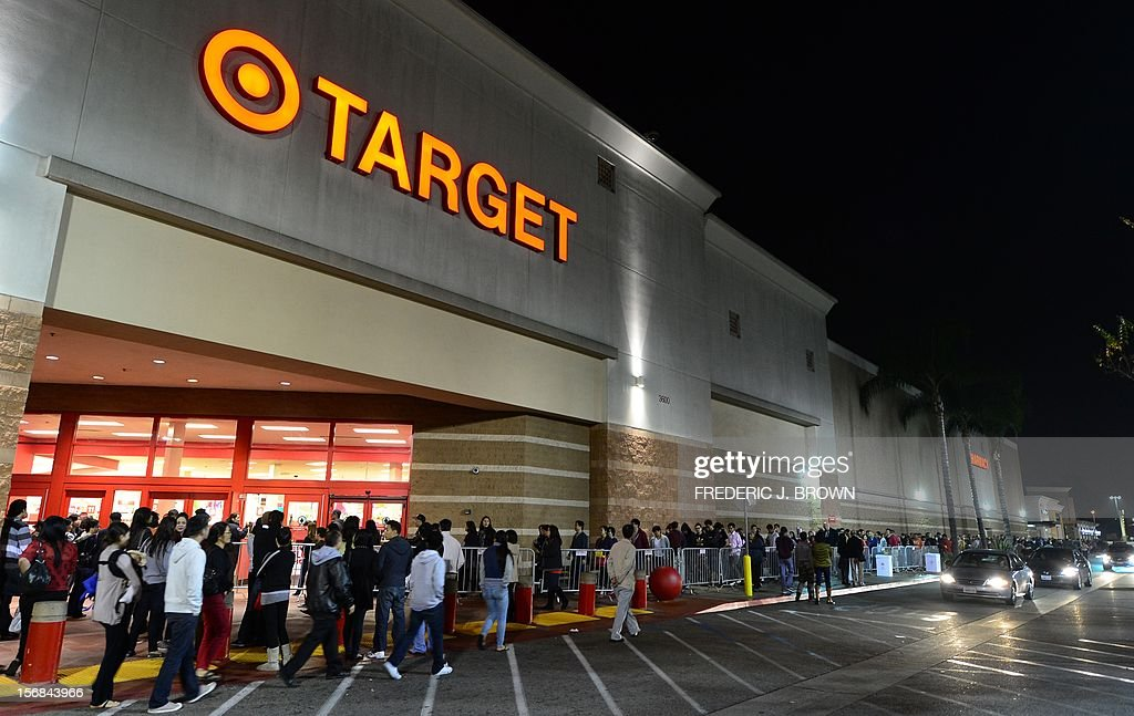 People wait in line to get an early start on Black Friday shopping deals at a Target store on November 22, 2012 in Rosemead, California, as many retailers stayed opened during the Thanksgiving celebrations, evidence that even this cherished American family holiday is falling prey to the forces of commerce. AFP PHOTO / Frederic J. BROWN