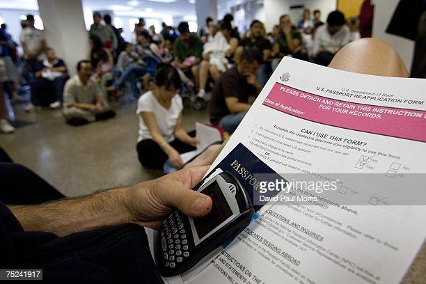 People wait in line to get their passport applications submitted at the United States passport agency office July 6 2007 in San Francisco California...