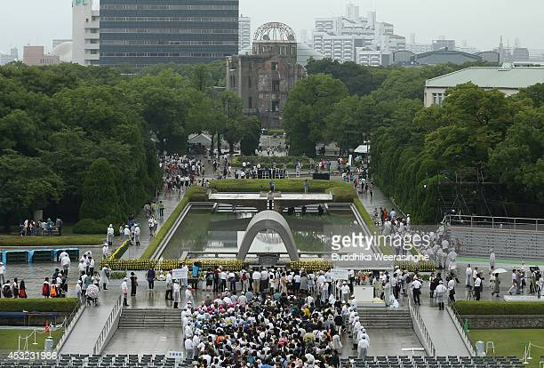People wait in line to pray at the Hiroshima Peace Memorial Park on the day of the 69th anniversary of the atomic bombing of Hiroshima on August 6...