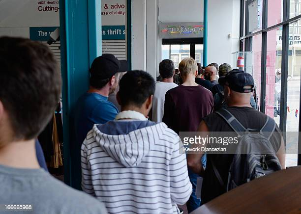 People wait in line to receive a free meningitis vaccine from Dr Wayne Chen at the AIDS Healthcare Foundation pharmacy on April 15 2013 in Hollywood...
