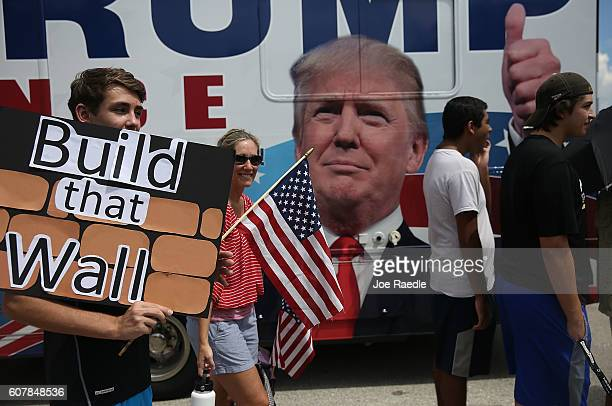People wait in line to see Republican presidential candidate Donald Trump speak during a campaign rally at the Germain Arena on September 19 2016 in...