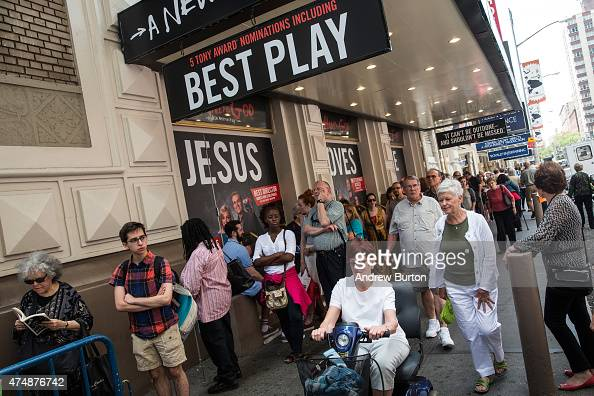 People wait in line to see the matinee show of Hand to God on May 27 2015 in New York City The Broadway season broke records with 131 million...