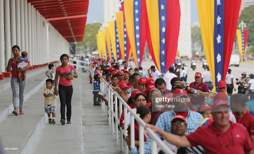 People wait in line to view the body of deceased Venezuelan President Hugo Chavez outside the Military Academy on March 9, 2013 in Caracas, Venezuela. Venezuelans continue to wait in line for hours to pay their last respects to Chavez on the day after his funeral. Venezuela's elections commission has set April 14 as the date for voting to replace the late Chavez.