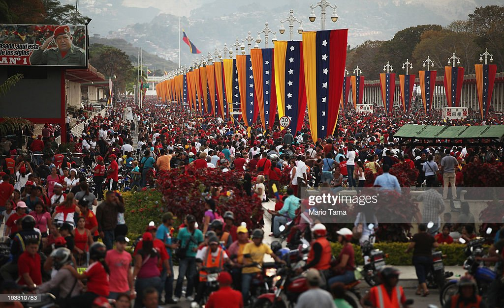 People wait in line to view the remains of late Venezuelan President Hugo Chavez as other gather outside the Military Academy on March 7, 2013 in Caracas, Venezuela. Countless Venezuelans waited on a mile-long line to pay their last respects to Chavez before his funeral tomorrow.