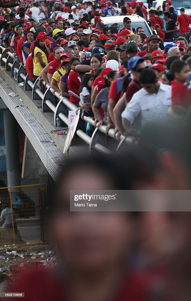People wait in line to view the remains of late Venezuelan President Hugo Chavez near the Military Academy on March 7, 2013 in Caracas, Venezuela. Countless Venezuelans waited on a mile-long line to pay their last respects to Chavez before his funeral tomorrow.