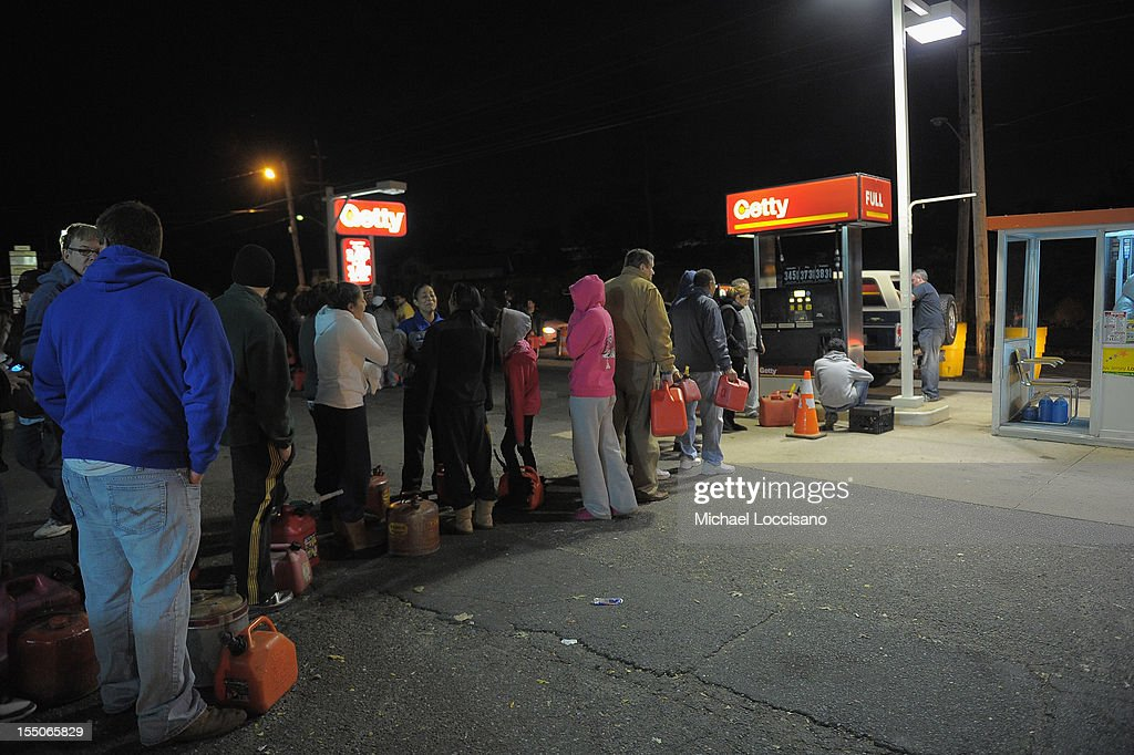 People wait in line with gas canisters at a Getty gas station on October 31, 2012 in Sayreville, New Jersey. Many gas stations in Middlesex, Monmouth and Ocean counties, and elsewhere in New Jersey are closed and sold out of gasoline due to extensive power outages caused by Hurricane Sandy.