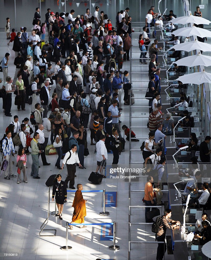 People wait in lines at Immigration inside the new Bangkok Suvarnabhumi international airport January 30 2007 in Bangkok Thailand The new $4 billion...