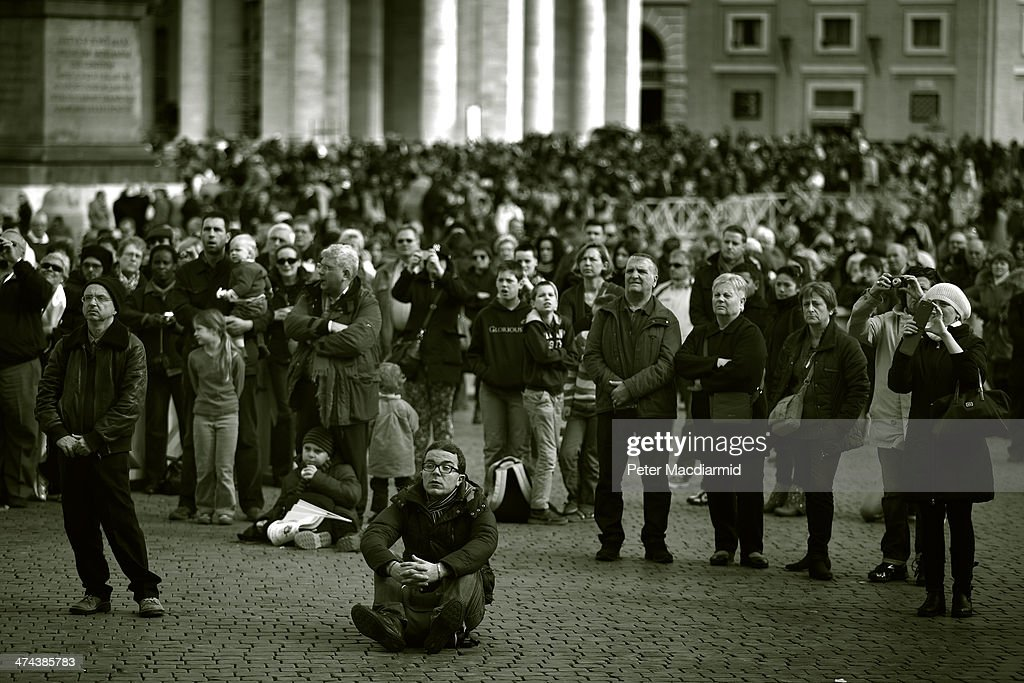 People wait in St Peter's Square for Pope Francis to give the Angelus blessing on February 23, 2014 in Vatican City, Vatican. Pope Francis created 19 new cardinals yesterday in a ceremony in St Peter's Basilica.