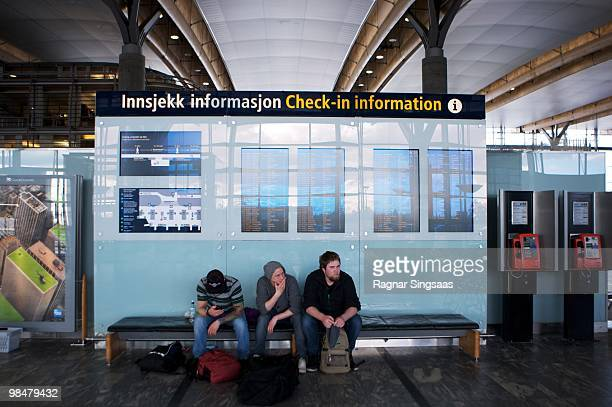 People wait in the departure lounge for information at Oslo Airport Gardermoen on April 15 2010 in Oslo Norway All flights in and out of Norway have...