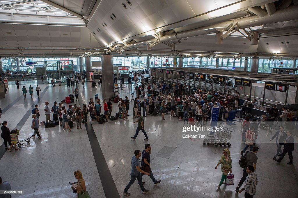 People wait in the departure terminal at the country's largest airport, Istanbul Ataturk following yesterday's blast on June 29, 2016 in Istanbul, Turkey. Three suicide bombers opened fire before blowing themselves up at the entrance to the main international airport in Istanbul yesterday. The Istanbul Governor's Office says 41 people have been killed, 37 of the victims have been identified, including 10 foreign nationals and three people with dual citizenship. More than 230 people were wounded but 109 have been discharged from hospitals in the deadly suicide bombing attack in Istanbul's Ataturk airport blamed on the Islamic State group.