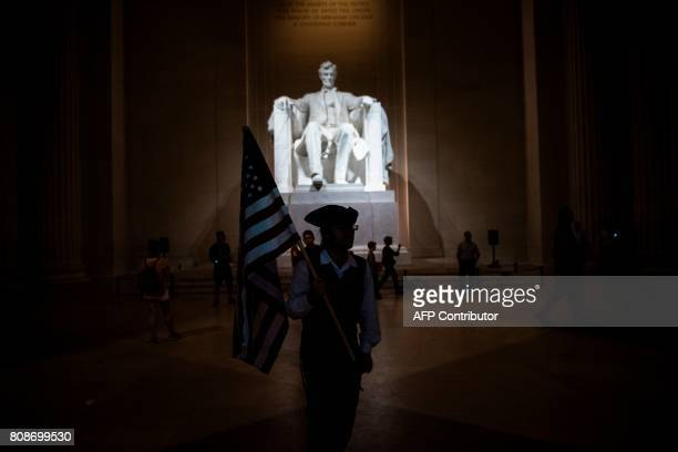 TOPSHOT People wait in the Lincoln Memorial for fireworks to celebrate US independence day on July 4 2017 in Washington DC / AFP PHOTO / Brendan...