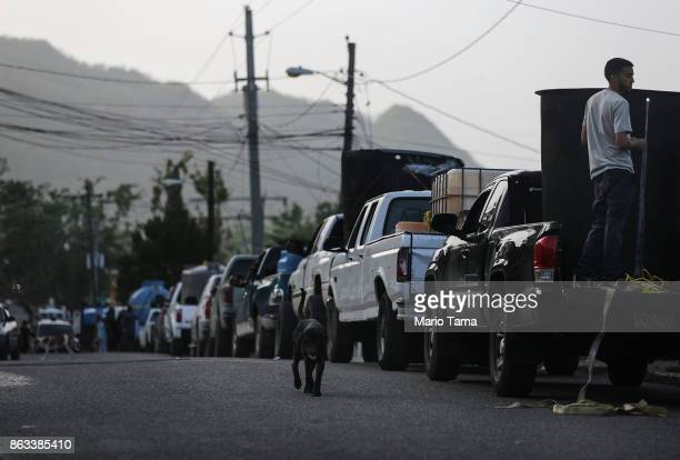 People wait in their cars in line to collect water nearly one month after Hurricane Maria struck on October 19 2017 in San Pedro Puerto Rico Those in...