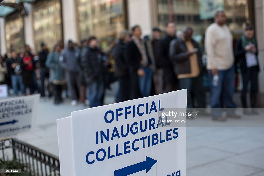 People wait ina line that snakes down the street at the entrance to the official inauguration merchandise store January 20, 2013 in Washington D.C. Despite this crowd, souvenir vendors are reporting slow sales compared to the 2009 inauguration, which brought crowds of unprecedented size to the capital.