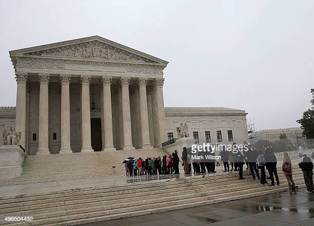 People wait inline to enter the US Supreme Court November 10 2015 in Washington DC Today the high court is hearing oral arguments in Tyson Foods v...