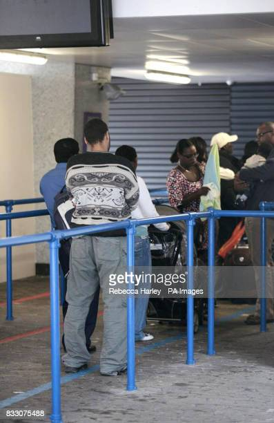 People wait inside Lunar House the Home Office Border and Immigration Agency West Croydon London