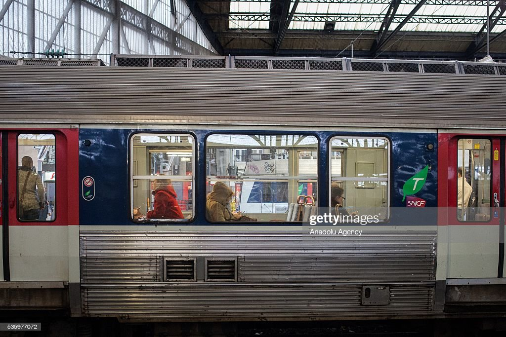 People wait inside the train for the departure in Gare Saint-Lazare Train Station, Paris, France on May 31, 2016.