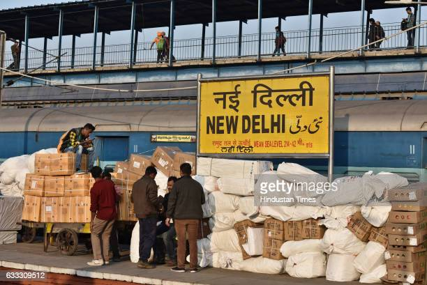 People wait on a platform as a train is unloaded in New Delhi Railway Station on February 1 2017 in New Delhi India The first Union Budget comprising...