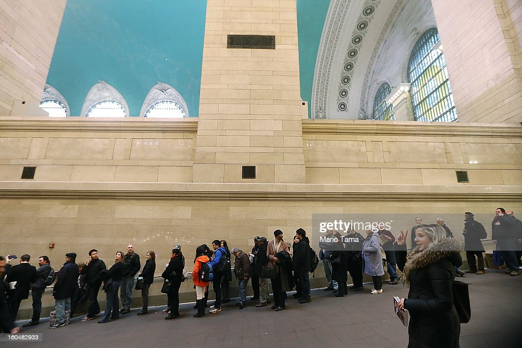 People wait on line in Grand Central Terminal for commemorative stamps during centennial celebrations on the day the famed Manhattan transit hub turns 100 years old on February 1, 2013 in New York City. The terminal opened in 1913 and is the world's largest terminal covering 49 acres with 33 miles of track. Each day 700,000 people pass through the terminal where Metro-Noth Railroad operates 700 trains per day.